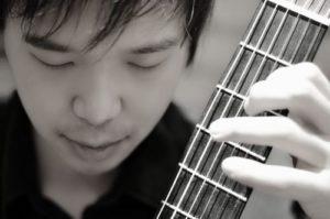 Gitarrenlehrer Tenghuang Hong in Schleswig